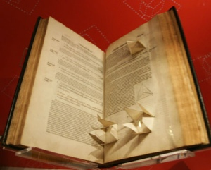 "There are certainly much earlier works that tried to get at a fuller representation of geometrical objects, not the least of which was a 16th century Elements of Euclid in which the figures were cut-out paper, pasted into the book and attached to a string so that the reader could pull out the illustration and see it displayed in three dimensions. The elements of geometrie of the most auncient philosopher Euclide of Megara. Faithfully (now first translated into the Englishe toung…3, printed in London in 1570, was no doubt a great and exasperating labor of love, a complex ""pop-up"" book accomplished with sixteenth century technology. (The photo below shows the Smithsonian Institution's copy.)"